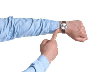 Young man with wristwatch on white background. Time concept