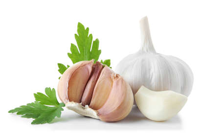 Fresh garlic and parsley on white background Standard-Bild