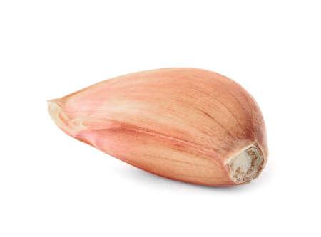 Fresh unpeeled garlic clove on white background
