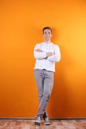 Handsome young man smiling on color background Reklamní fotografie