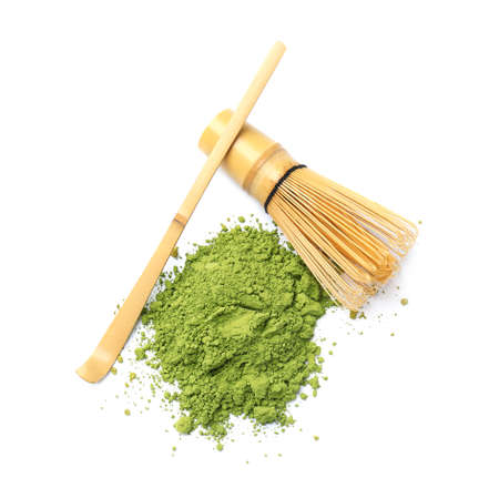 Powdered matcha tea, chashaku and chasen on white background, top view
