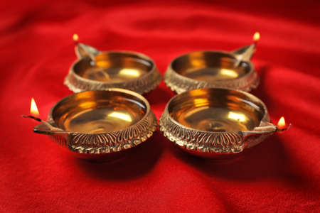 Diwali diyas or clay lamps on color fabric