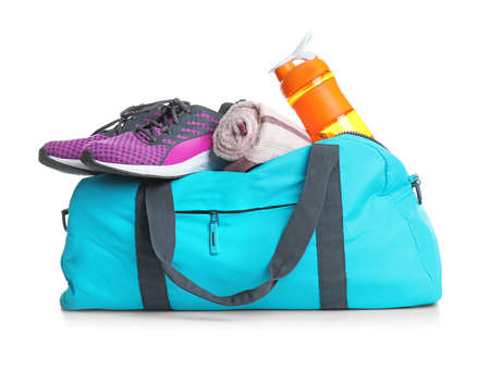 Sports bag and gym stuff on white background Stock Photo