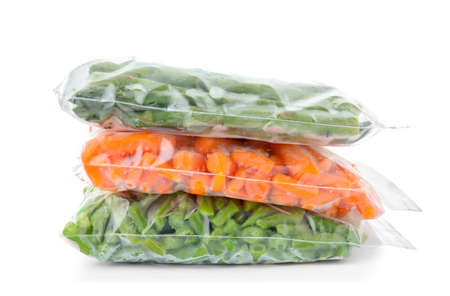 Plastic bags with frozen vegetables on white background Zdjęcie Seryjne - 106103736