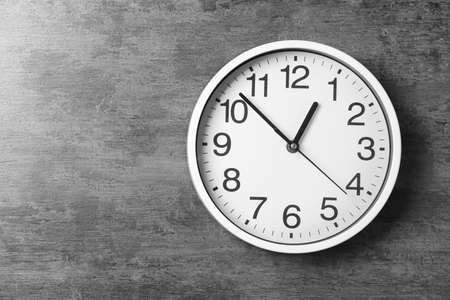 Modern clock on grey background, top view. Time management 스톡 콘텐츠