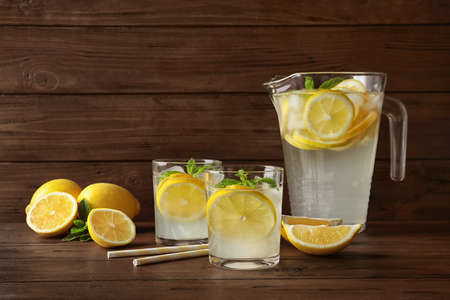 Glassware with natural lemonade on wooden table