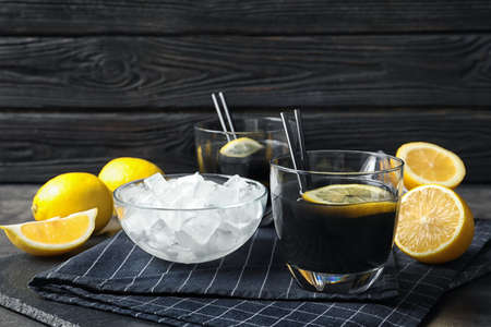 Glasses with natural black lemonade on table