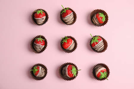 Flat lay composition with chocolate covered strawberries on color background Archivio Fotografico - 106077701