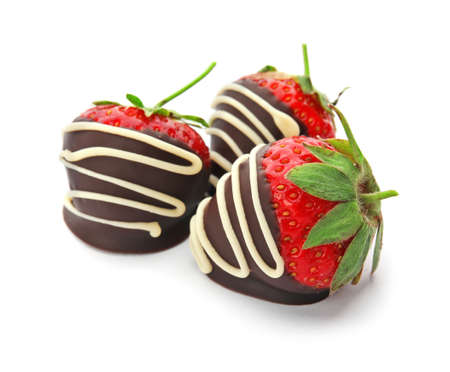Delicious chocolate covered strawberries on white background