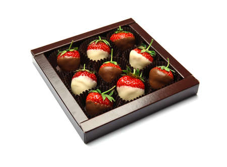 Box with chocolate covered strawberries on white background