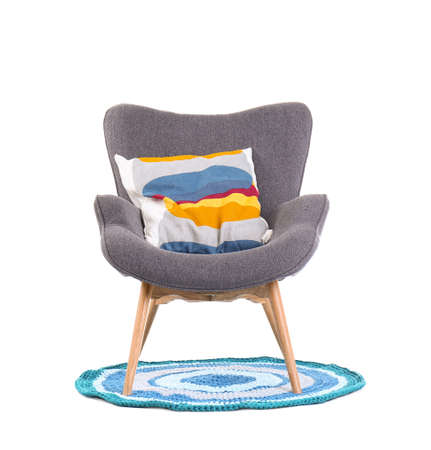 Comfortable armchair with pillow on white background. Interior element Stock Photo