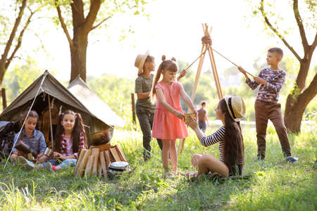 Little children near tent outdoors. Summer camp Stockfoto - 106373315