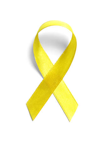 Yellow ribbon on white background, top view. Cancer awareness