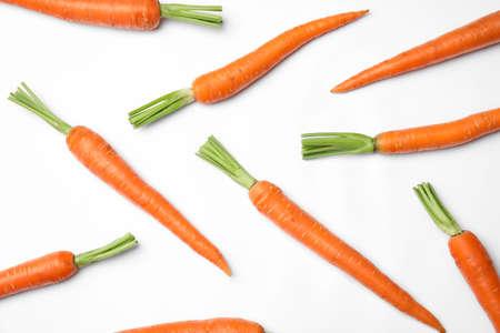 Ripe fresh carrots on white background
