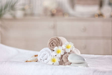 Towels and candles on massage table in modern spa salon. Place for relaxation Stock Photo