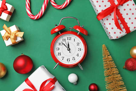 retro alarm clock and different decor on color background top view christmas countdown stock