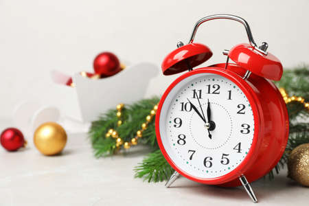 retro alarm clock and decor on table christmas countdown stock photo 106047915