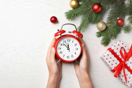 stock photo woman holding retro alarm clock on table christmas countdown