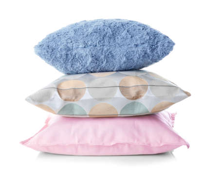 Soft decorative pillows on white background
