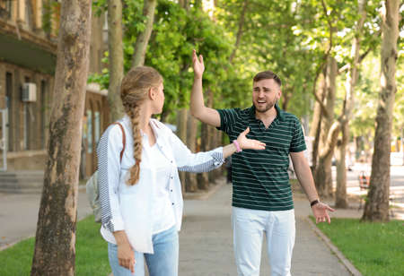 Young couple arguing on street. Problems in relationship