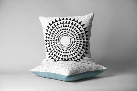 Soft decorative pillows on light background