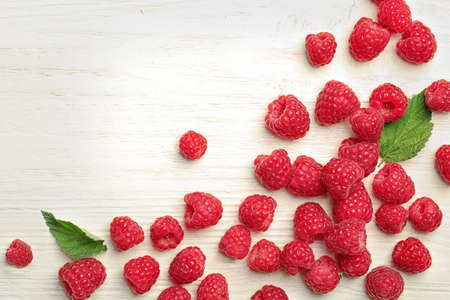 Ripe aromatic raspberries on wooden table, top view Stock Photo