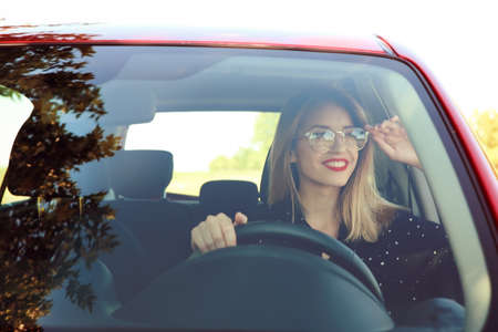 Young woman on driver's seat of car Stock Photo