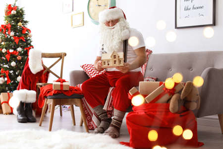 Authentic Santa Claus making toy in workshop