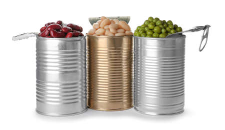 Tin cans with conserved vegetables on white background Foto de archivo