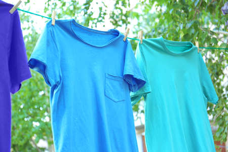 Clothes on laundry line outdoors on sunny day