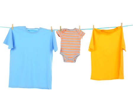 Clothes on laundry line against white background Archivio Fotografico