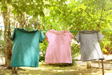 Laundry line with clothes outdoors on sunny day