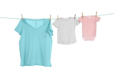 Clothes on laundry line against white background Stock Photo