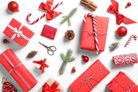 Flat lay composition with Christmas gifts on white background Foto de archivo