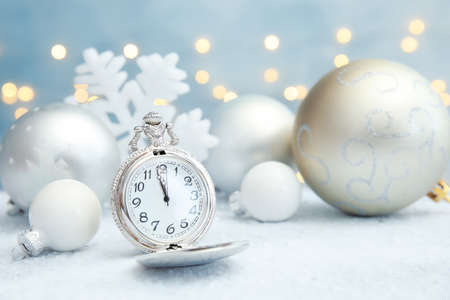 Pocket watch and festive decor on table. Christmas countdown Banque d'images