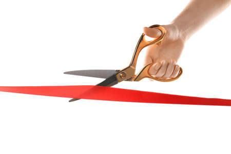Woman cutting red ribbon on white background