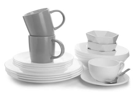 Different clean tableware on white background