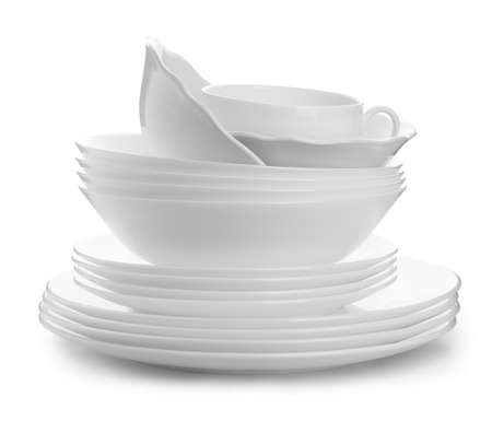 Stack of plates and cup on white background