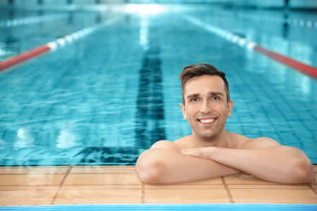 Young athletic man in swimming pool