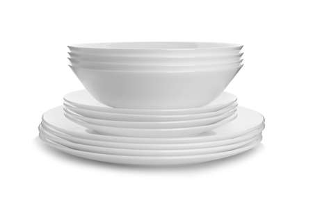 Stack of clean plates on white background