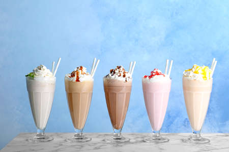 Glasses with delicious milk shakes on table 스톡 콘텐츠