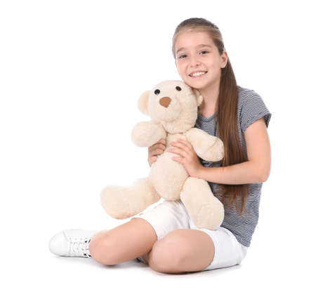 Playful little child with plush toy on white background. Indoor entertainment 免版税图像