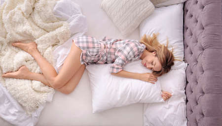 Young beautiful woman sleeping in bed at home, top view. Early morning Stok Fotoğraf