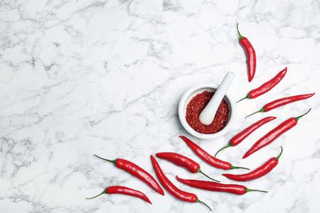 Flat lay composition with chili peppers on marble background