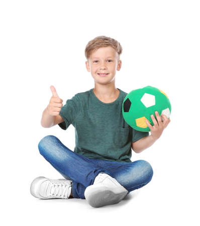Playful little child with soccer ball on white background. Indoor entertainment Foto de archivo