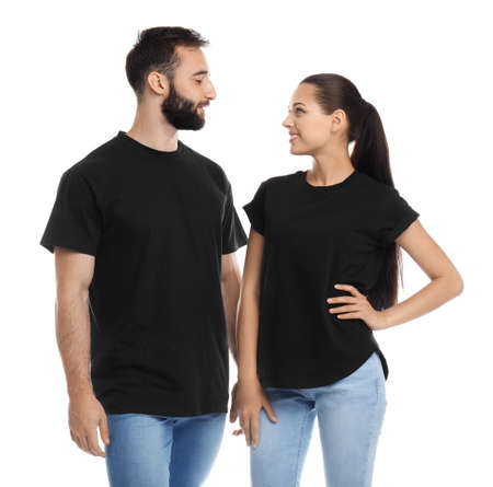 Young couple in t-shirts on white background. Mockup for design Reklamní fotografie - 106504419
