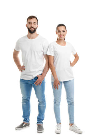 Young couple in t-shirts on white background. Mockup for design