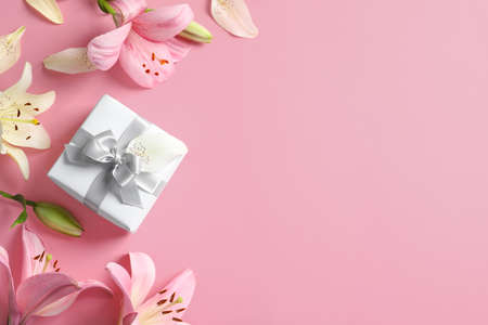 Flat lay composition with beautiful blooming lily flowers on color background Stock Photo