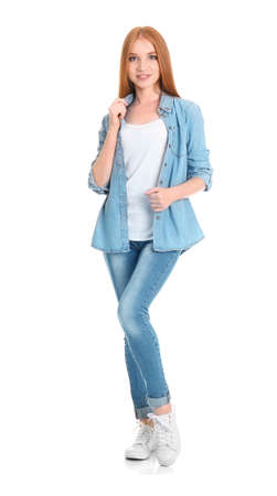 Young woman in stylish jeans on white background Stock Photo
