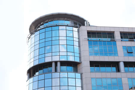 Building with tinted windows. Modern architectural design